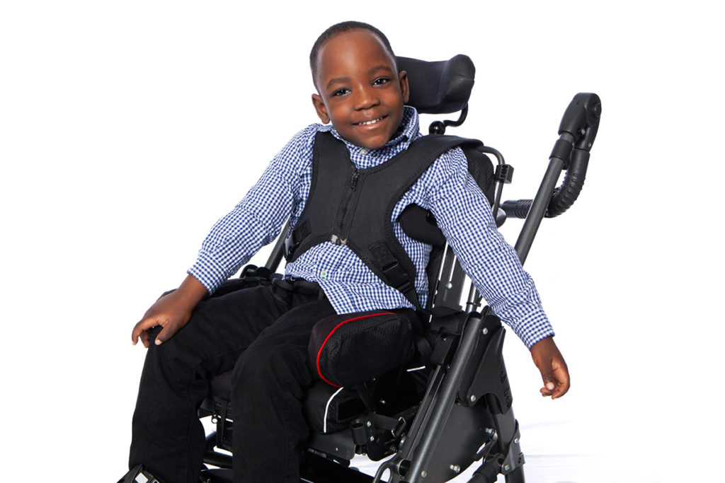 Ethan sits in his wheel chair