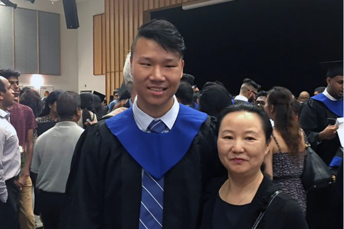 Leon Li - a scholarship recipient at graduation with his mom.